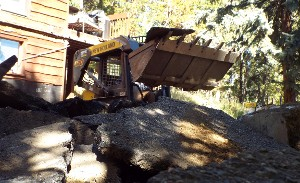Bulldozer Breaking Up Foundation