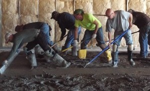 Workers Spreading out Concrete