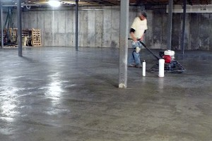 Worker Buffing a Concrete Floor