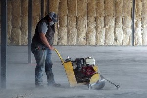 Worker Cutting a Concrete Floor